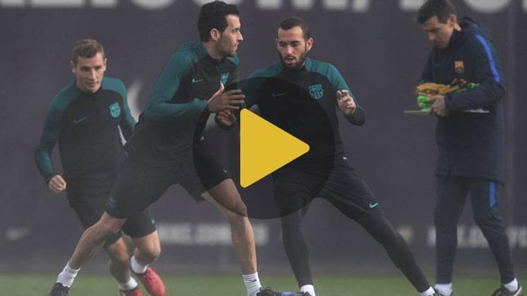 Caras sonrientes bajo la lluvia en el último entreno del Barça