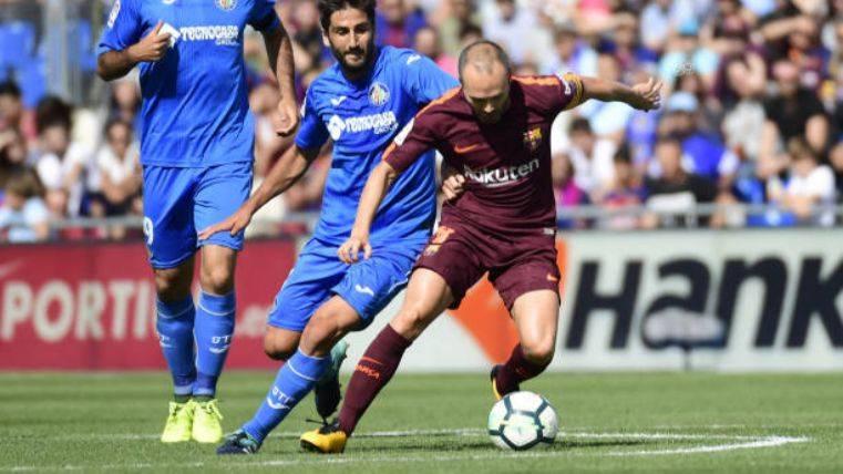 Iniesta admite el cambio de estilo y elogia a Paulinho