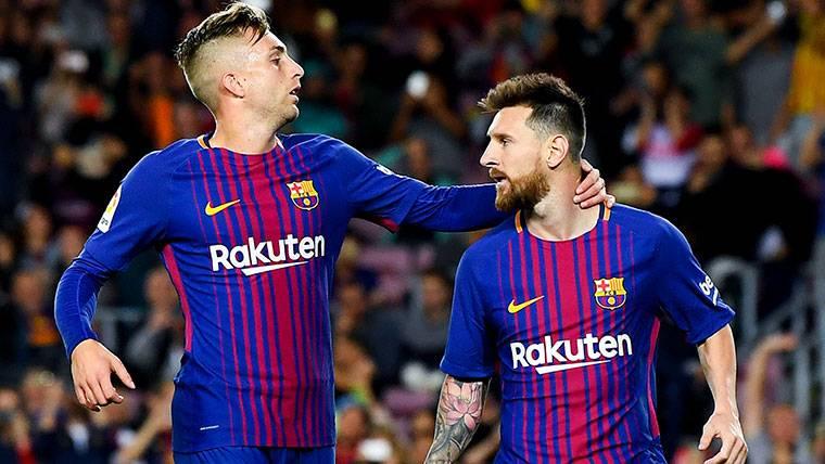 Gerard Deulofeu, celebrando un gol junto a Leo Messi en el Barça