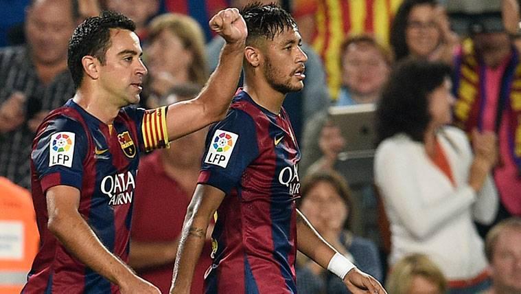 Xavi Hernández y Neymar celebran un gol del FC Barcelona