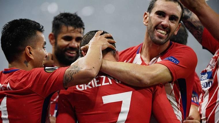 El Atlético, celebrando uno de los goles de Griezmann al Marsella
