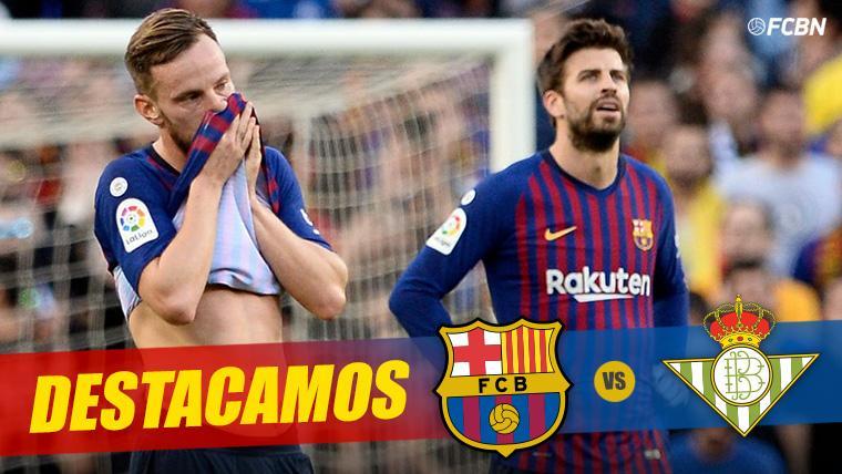Ivan Rakitic y Gerard Piqué, lamentando un gol recibido ante el Betis