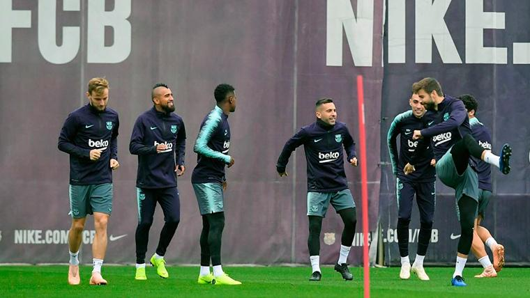 Jordi Alba y Munir El Haddadi, entrenando con sus compañeros en el Barça