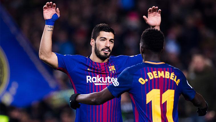 Luis Suárez y Ousmane Dembélé celebran un gol del FC Barcelona