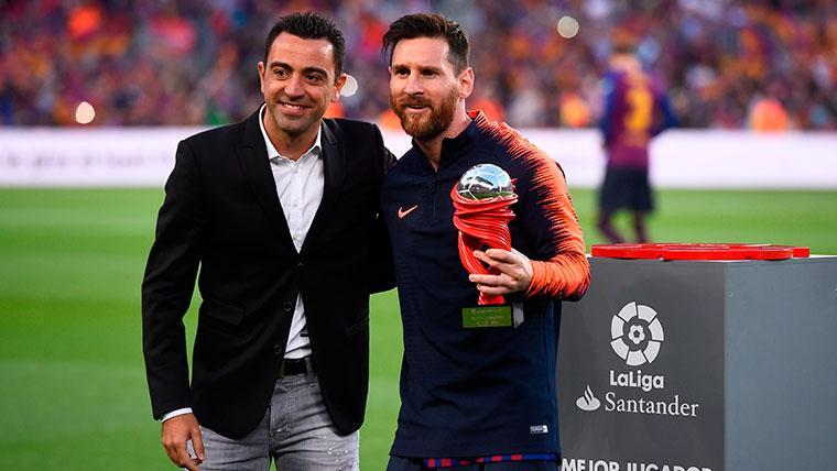 Xavi Hernández y Leo Messi en un acto de LaLiga