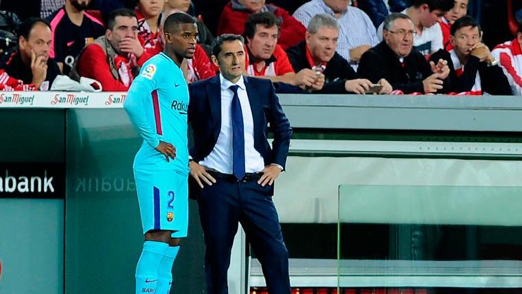 Nélson Semedo y Ernesto Valverde en un partido del FC Barcelona